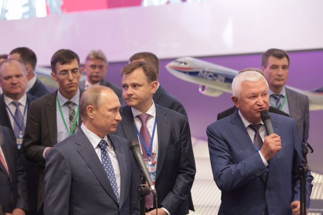 Vladimir Putin and Oleg Demchenko visiting exposition of Irkut Corporation